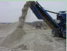 New aggregate coming off the belt - blue crusher.